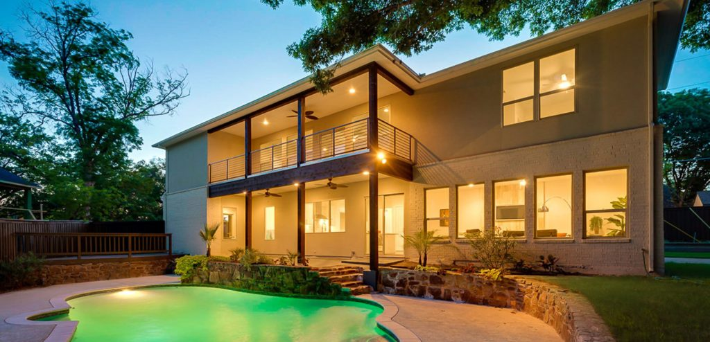 Beautifully lit home with a swimming pool
