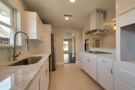 Kitchen with all white cabinets and appliances