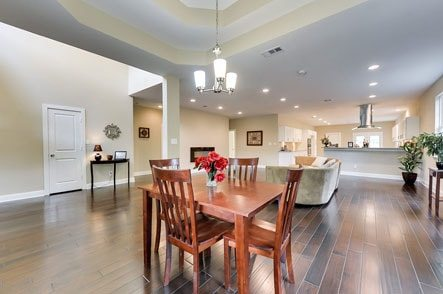 Beautiful open floor plan showing a wood dining table with 4 chairs
