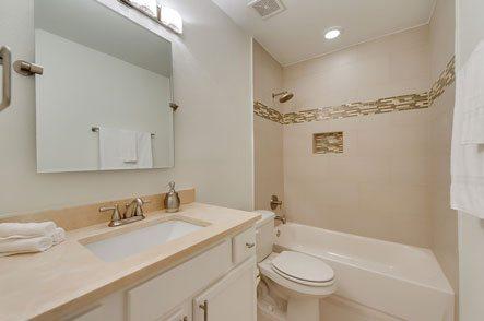 Elegant bathroom with tile in beige tones