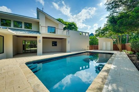 Built in swimming pool in the backyard of a very modern home design