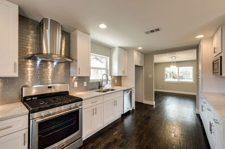 Kitchen with a stainless steel range and wooden floors