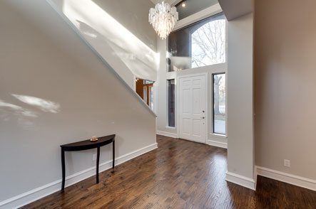 Entryway with large vaulted ceilings