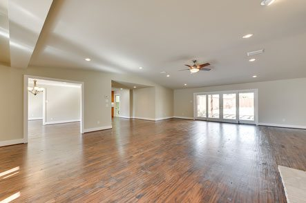 Vacant large open floorplan with hardwood floors
