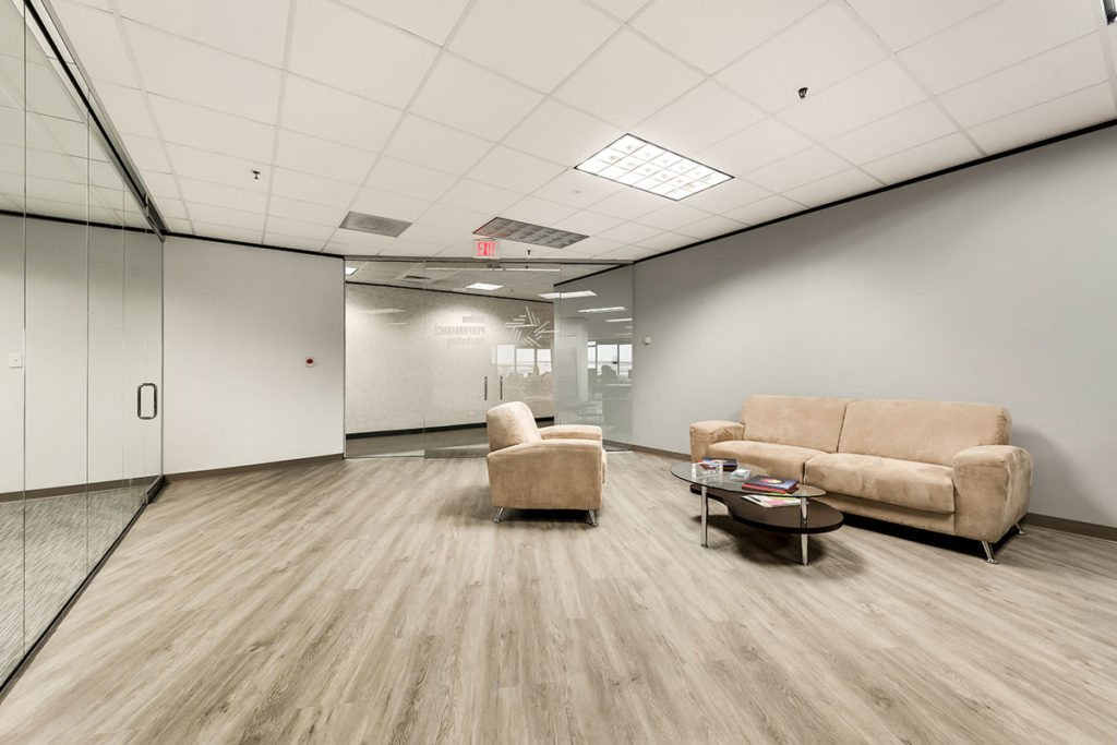 Waiting area with gray walls and tan sofas
