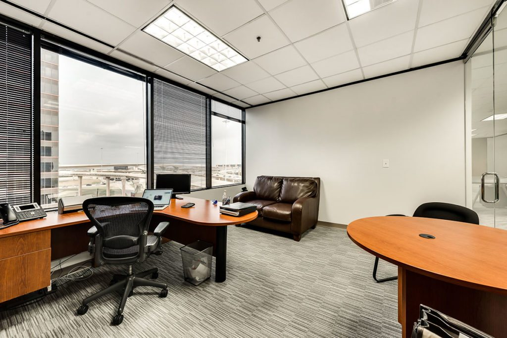 Office with large windows and 2 desks