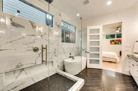 Beautifully remodeled bathroom with granite and glass shower