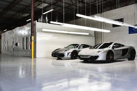 2 expensive cars parked in a parking garage